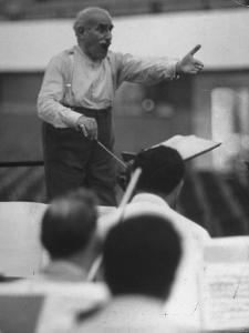 Conductor Arturo Toscanini, Singing and Shouting Instructions While Rehearsing His Men in a Gym by Joe Scherschel