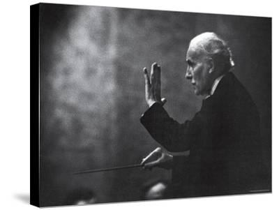 Conductor Arturo Toscanini Waving His Arms During the First Half Program of the Toscanini Tour