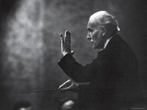 Conductor Arturo Toscanini Waving His Arms During the First Half Program of the Toscanini Tour by Joe Scherschel