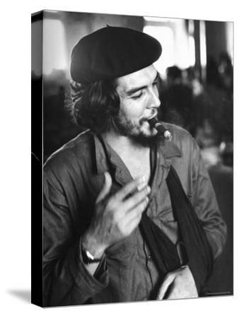 "Cuban Rebel Ernesto ""Che"" Guevara, Left Arm in a Sling, Talking with Unseen Person"