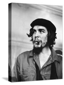 """Cuban Rebel Ernesto """"Che"""" Guevara with Lit Cigar Clenched Between Teeth and Left Arm in a Sling by Joe Scherschel"""