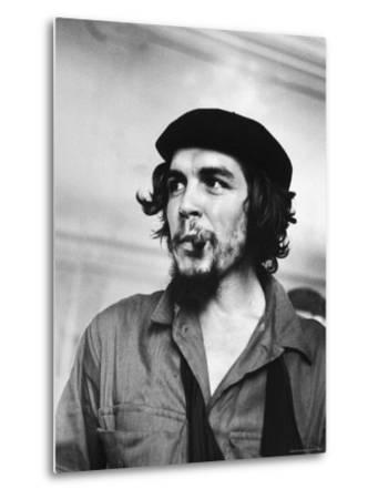 """Cuban Rebel Ernesto """"Che"""" Guevara with Lit Cigar Clenched Between Teeth and Left Arm in a Sling"""