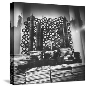DJ William B. Williams Sitting Amid the 8,000 Records a DJ Receives Each Year from Record Companies by Joe Scherschel