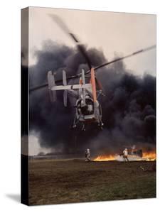 Firefighting Helicopter Dousing Flames by Joe Scherschel