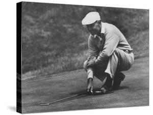 Golfer Ben Hogan Lining Up His Putt by Joe Scherschel