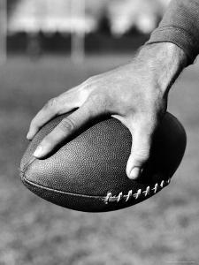 Holding the Football is Player Paul Dekker of Michigan State by Joe Scherschel