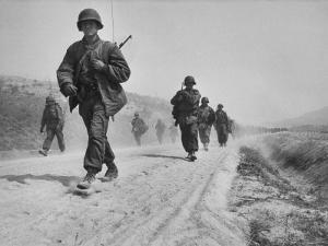 Kicking Up Dust, a Withdrawing Unit Heads South by Joe Scherschel