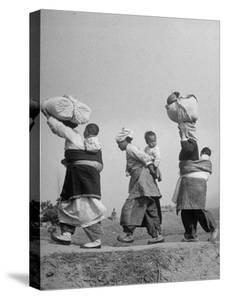 Korean Mothers and Children Giving Up Home for Third Time Because of the New Chinese Offensive by Joe Scherschel