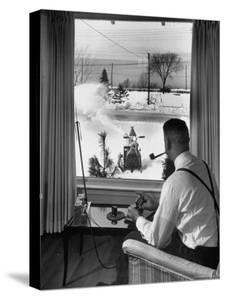 Man Operating Remote Control Snow Plow by Joe Scherschel