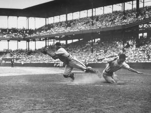 Pittsburgh Player Sliding to Home Plate before St. Louis Cardinal Catcher Gets the Ball by Joe Scherschel