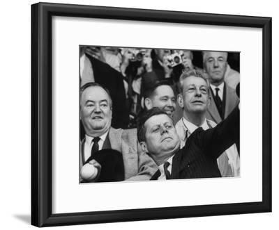President John F. Kennedy Tossing Out 1st Ball of Baseball Season at Senators Game