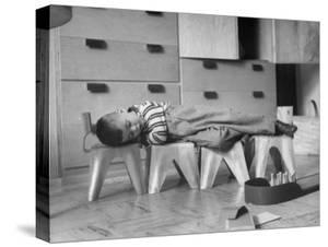 Rocky Stensrud, Jr., Using Children's Chairs in a Home to Make a Train Upon Which He Can Sleep by Joe Scherschel