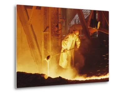View of a Steel Worker Working in Protective Clothing