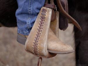 A Close-up of a Cowboy Boot in a Stirrup in the Nebraska Sandhills by Joel Sartore