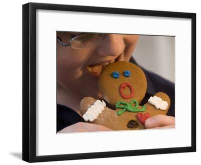 A Gingerbread Man Reacts to Being Eaten by a Young Male