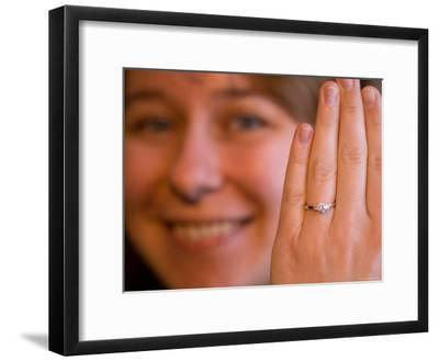 A Happy Female Holds up Her Diamond Engagement Ring