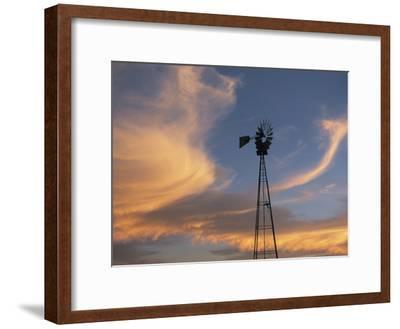 A Lone Windmill Dots the Prairie Landscape
