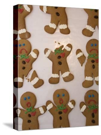 A Sheet of Gingerbread Men with Different Facial Expressions