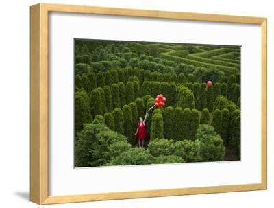 Balloons Drift Away from a Young Woman in the Garden Maze at Luray, Virginia