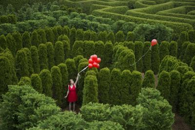 Balloons Drift Away from a Young Woman in the Garden Maze at Luray, Virginia