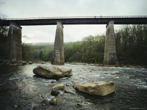 Cyclists on a Bridge Above the Youghiogheny River by Joel Sartore