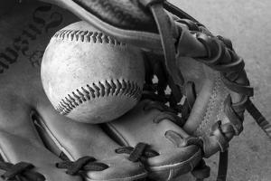 Detail Shot of a Baseball and Baseball Glove by Joel Sartore