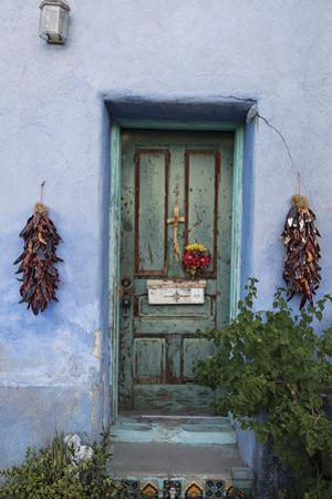 Dried chilies frame a door in Tucson's Barrio Viejo. by Joel Sartore