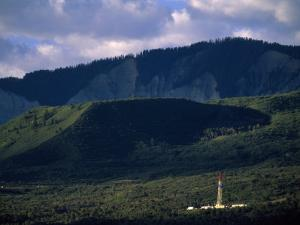 Gas Drilling Rig at the Foot of the Roan Plateau by Joel Sartore