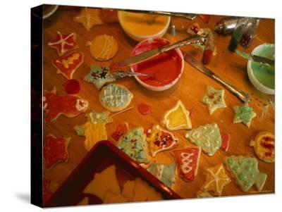 Holiday Cookies are Decorated with Colored Frosting and Sprinkles