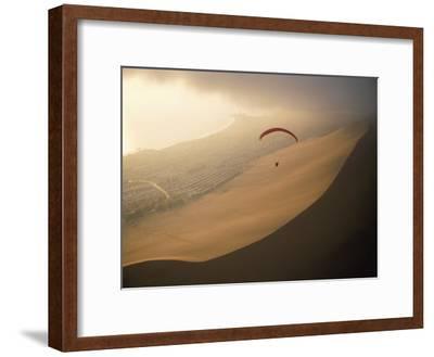 Ocean Gusts Keep a Paraglider Aloft Above Cerro Dragon, a Desert Dune