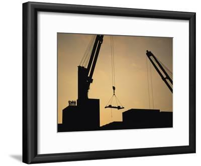 Silhouette of Cranes and Workers at the Port of Antofagasta