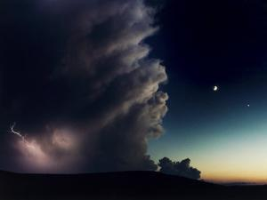Thunderstorm, Evening Star, and Crescent Moon Collide on a Hilltop by Joel Sartore