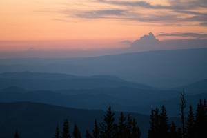 View of sunset over Aspen Mountain of the Elks Mountain range. by Joel Sartore