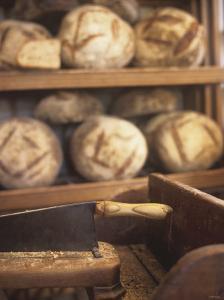 Bread on Shelves at a Baker's by Joerg Lehmann