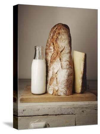 Milk Bottle, Bread and Cheese on a Wooden Cupboard