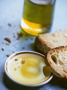 Olive Oil on Plate with Slices of Bread & Olive Oil Bottle by Joerg Lehmann