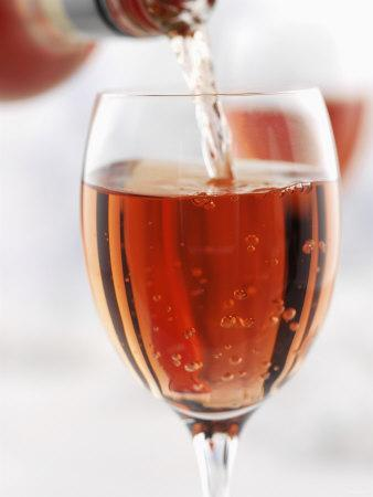Pouring Rose Wine into Wine Glass