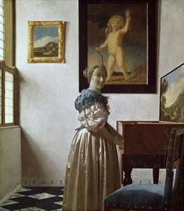 A Young Woman Standing at a Virginal. C.1670 by Johannes Vermeer