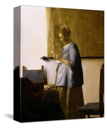 Woman Reading a Letter, circa 1662-63