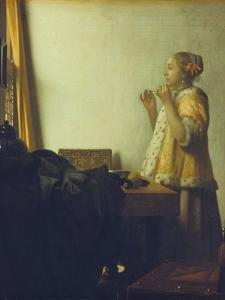 Young Woman with a Pearl Necklace, about 1662/65 by Johannes Vermeer