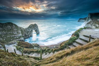 A Winter Sunset at Durdle Door on the Jurassic Coast, Dorset, England, United Kingdom, Europe
