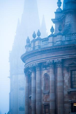 Radcliffe Camera and St. Mary's Church in the Mist, Oxford, Oxfordshire, England, United Kingdom