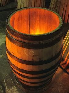 Toasting a New Oak Wine Barrel at the Demptos Cooperage, Napa Valley, California, USA by John Alves