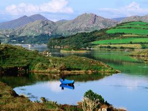 Blue Boat on Tranquil Kenmare River, Munster, Ireland by John Banagan