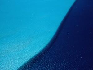 Ocean Water with Light Blue Indicating Shallow Sandy Sea Floor, Coral Bay, Australia by John Banagan