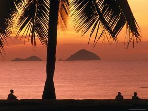 People on Nha Trang Beach at Sunrise, Nha Trang, Khanh Hoa, Vietnam by John Banagan