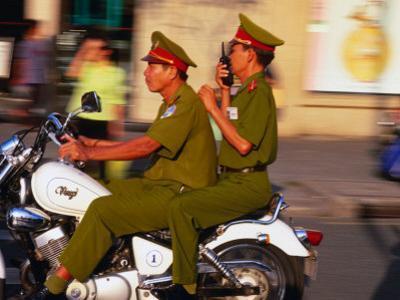 Policemen on Motorbike, Ho Chi Minh City, Vietnam