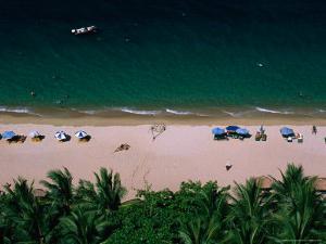 Sunbathers on Beach, Nha Trang, Vietnam by John Banagan