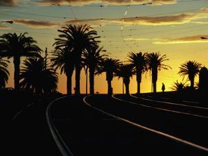 Sunset on Tram Tracks of St. Kilda Esplanade, Melbourne, Australia by John Banagan
