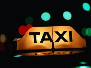 Taxi Light at Night, Adelaide, Australia by John Banagan